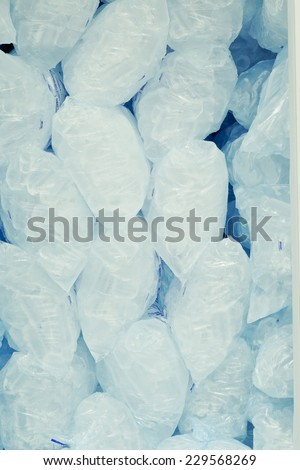 Ice cubes in blue plastic bags - stock photo