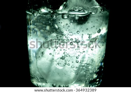 Ice cubes in crystal glass soda water elegant close up - stock photo