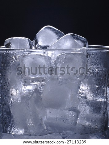 Ice cubes in glass in  black background - stock photo