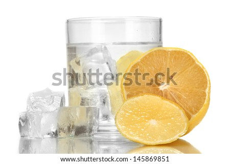 Ice cubes in glass with lemon isolated on white