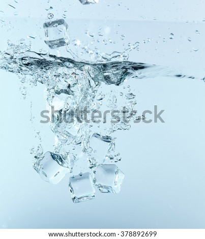 ice cubes in the water - stock photo