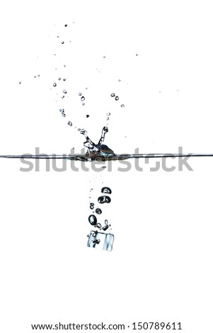 Ice cubes in water. Water splash - stock photo