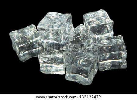 Ice cubes isolated on black - stock photo