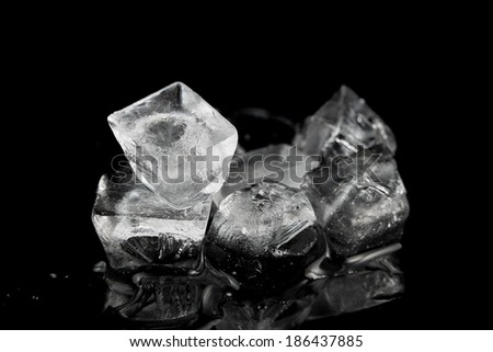 ice cubes on black background. - stock photo