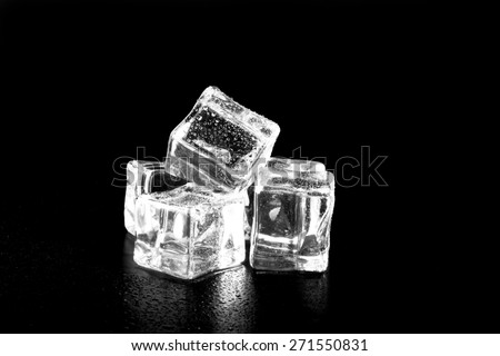 Ice cubes on black wet table. Selective focus.