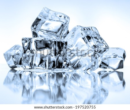 Ice cubes on blue background - stock photo