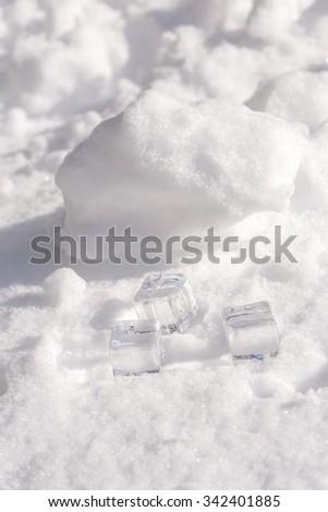 Ice cubes on snow  - stock photo