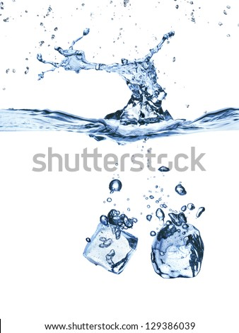 ice cubes splash in water isolated on white - stock photo