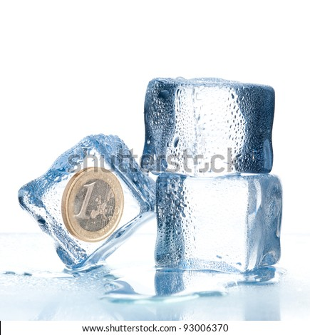 ice cubes with euro coin inside - stock photo