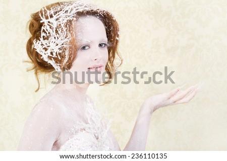 Ice fairy holding something  - stock photo