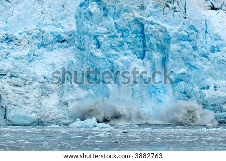 Ice falling from glacier in Alaska illustrating climate change - stock photo