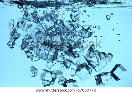 Ice falling in the fresh water - stock photo