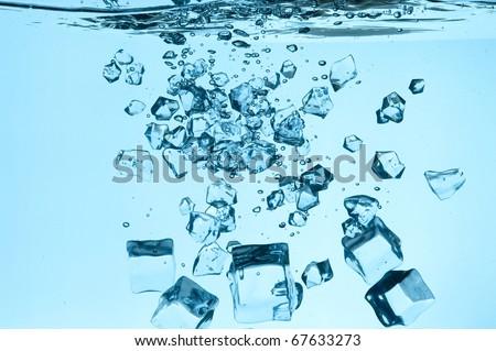Ice falling in  water - stock photo