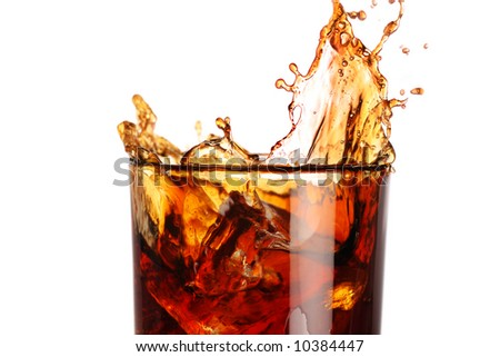 ice filled carbonated soft drink with a splash - stock photo