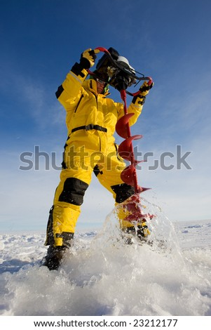 Ice fisherman drilling a hole with a power auger