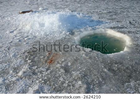 ice fishing hole - stock photo