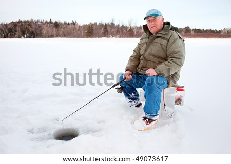 Ice Fishing on the Lake - stock photo
