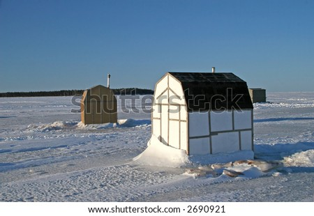Ice fishing shacks on the frozen harbour.