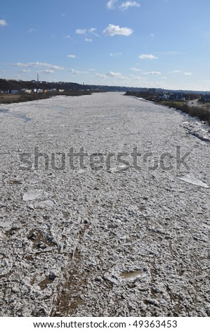 Ice floating down the river - stock photo