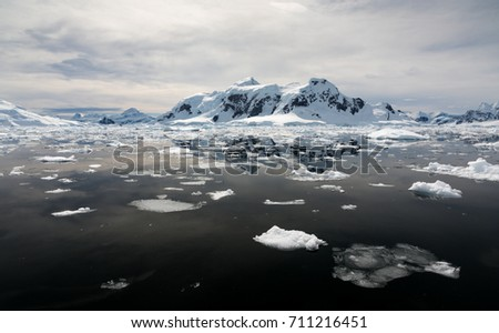 Ice floating in the ocean with mountain backdrop, Paradise Bay, Antarctica