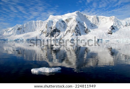 ice floe and mountains in antarctica - stock photo