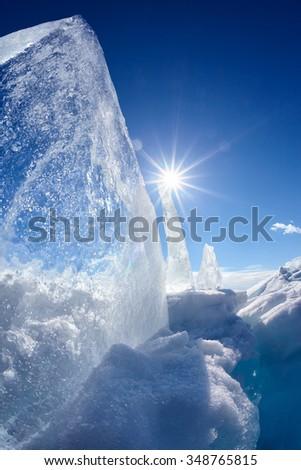 Ice floe and sun over winter Baikal lake - stock photo