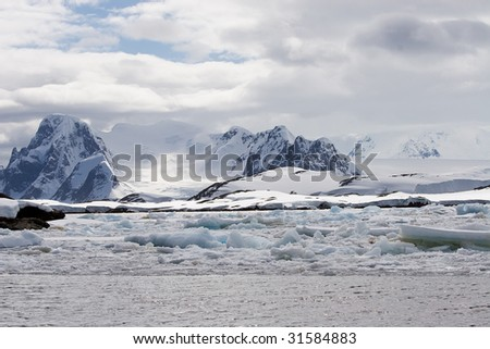 ice floes in front of glacier - stock photo