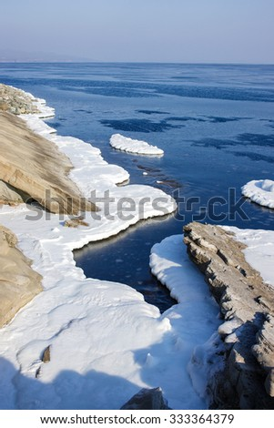 Ice floes in the sea, the block of ice on the sea, the winter sea and the ocean, Arctic, aquatic nature, the ice floe in the ocean, melting ice, spring in the North sea, the Arctic in the spring. - stock photo