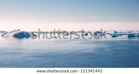 Ice floes on the sunset in Antarctica - stock photo