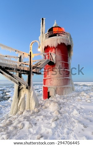Ice forming on South Haven Michigan Lighthouse, Lake Michigan - stock photo