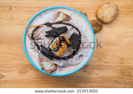 Ice frappe with Chocolate Flavored, cookies, bread and condensed milk. - stock photo