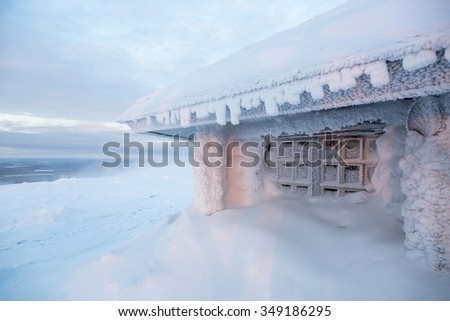 ice frozen house in Finland behind arctic circle - stock photo