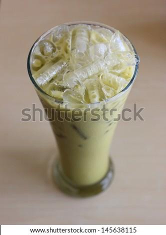 Ice Green tea on table - stock photo