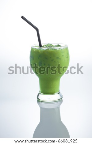 ice Green tea with a straw isolated on white background. - stock photo