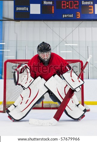 Ice hockey goalie in front of his net. Picture taken in ice arena. - stock photo