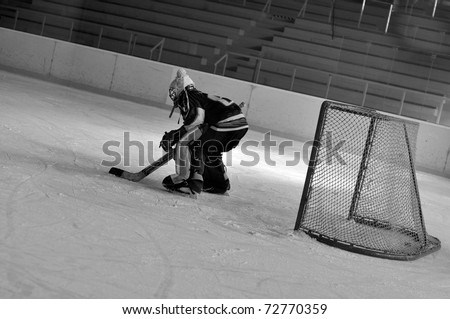 ice hockey goalie in goal - stock photo