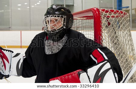Ice hockey goalie protecting his net