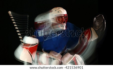 "Ice hockey goaltender in action. Studio photo using second-curtain flash to capture a motion trail and give an""action"" feel."