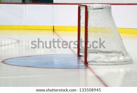 Ice hockey net and goalie crease - stock photo
