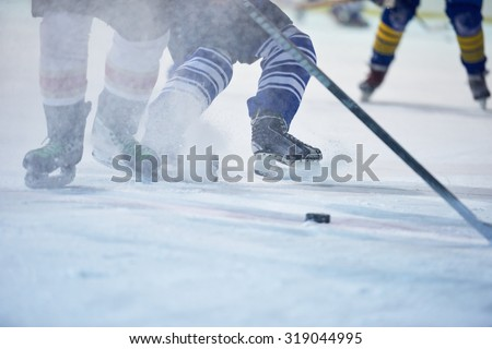 ice hockey player in action kicking with stick - stock photo