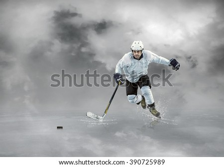 Ice hockey player in action outdoor. - stock photo