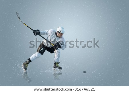 Ice hockey player on the ice and light effects - stock photo