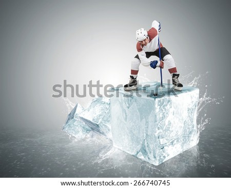 Ice hockey player on the ice cube during face-off - stock photo