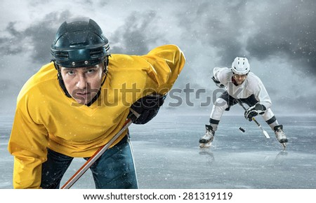 Ice hockey player on the ice in mountains - stock photo