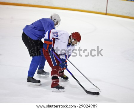 Ice hockey player skates with the puck - stock photo