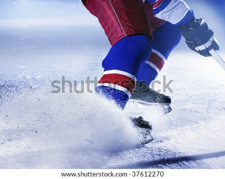 ice hockey player stoping on ice close up - stock photo