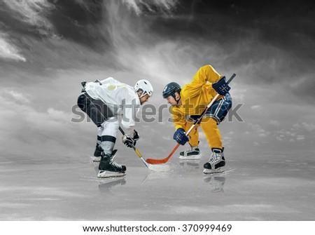 Ice hockey players on the ice under sky - stock photo
