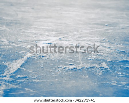 Ice hockey rink surface background, abstract blue, selective focus, shallow dof - stock photo