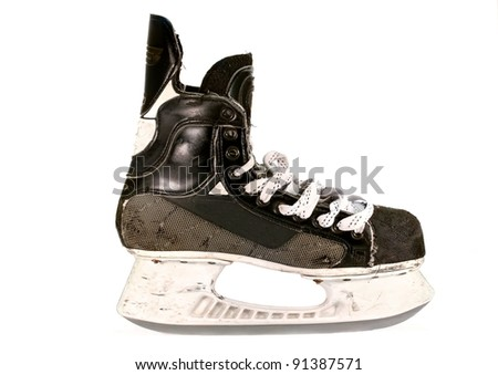 Ice hockey skate, isolated against a white background.  Close up details and texture of this scuffed up old skate. - stock photo