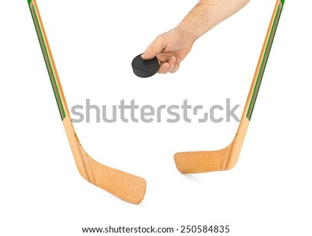 Ice hockey stick and hand with puck isolated on white background - stock photo